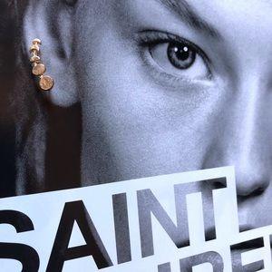 Neiman Marcus gold ear crawlers pierced ears